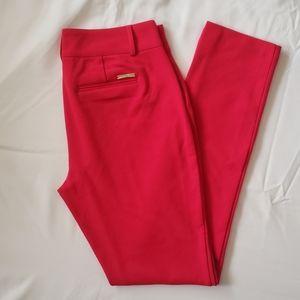 Michael Kors red holiday pants .